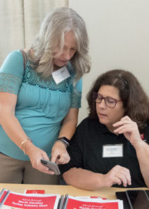 Summer Lanier and Lynn Strother looking at a phone