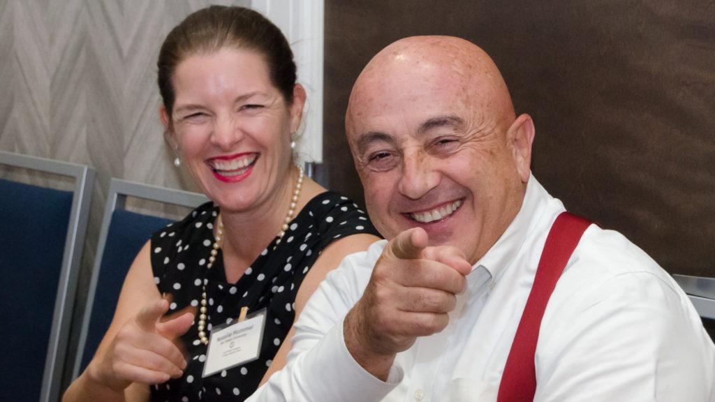 Natalie Hummel and Rich Bonanno pointing at the camera