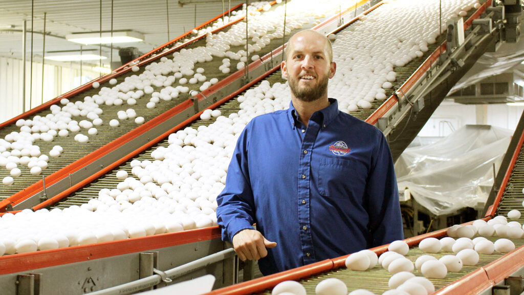 Trey Braswell in an egg production facility